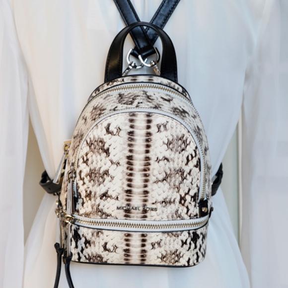 5b24612845fc Michael Kors RHEA mini snake embossed Backpack NWT